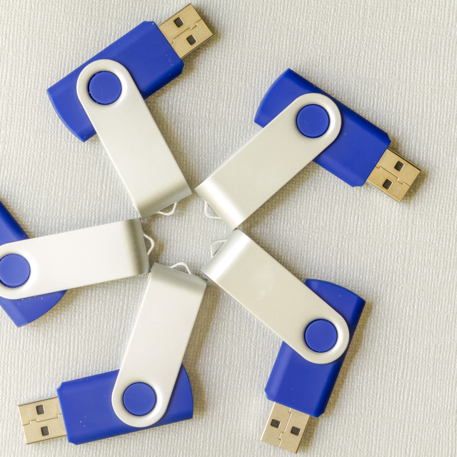 """USB flash drives on gray background"" stock image"