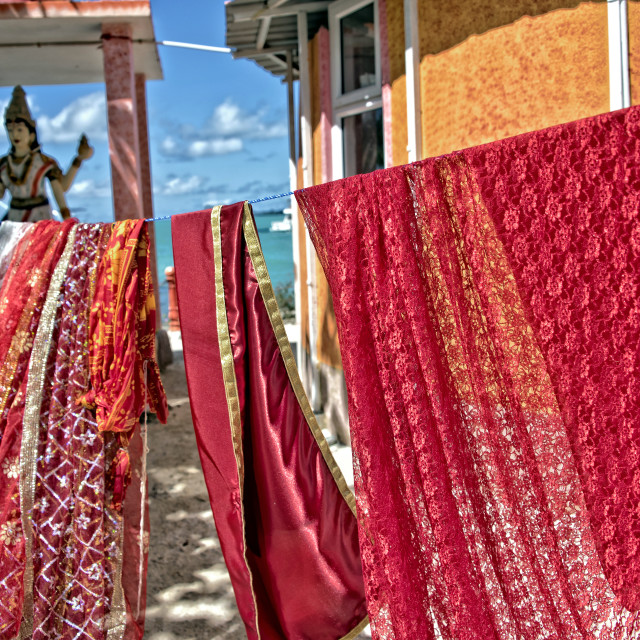 """Freshly washed clothes for the temple deities - Hindu temple, Mauritius"" stock image"