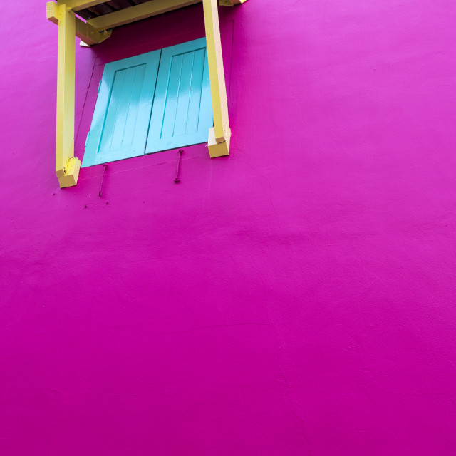 """Closed window shutters in pink wall"" stock image"