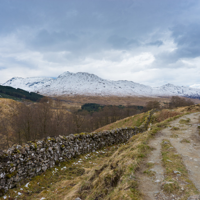 """""""West Highland Way walking trail with snowy mountains"""" stock image"""