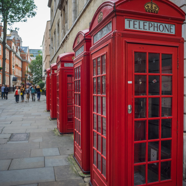 """""""Row of red phone telephone boxes in London"""" stock image"""