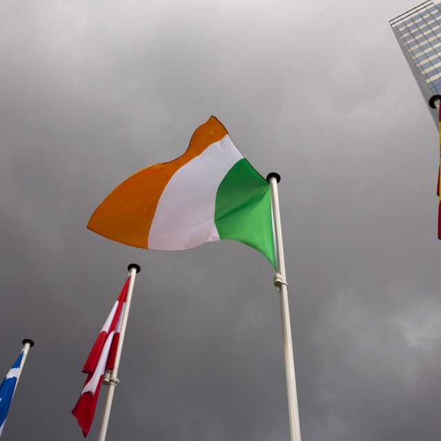 """""""Irish flag blowing in stormy weather, Brussels"""" stock image"""