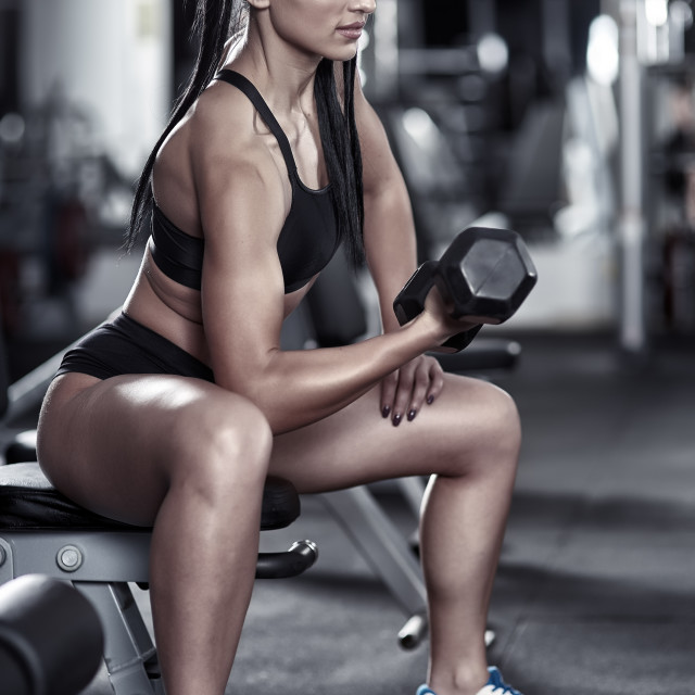 """""""Athletic woman doing biceps curl"""" stock image"""
