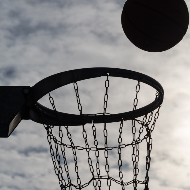 """Basketball hoop at sunset sky 4"" stock image"