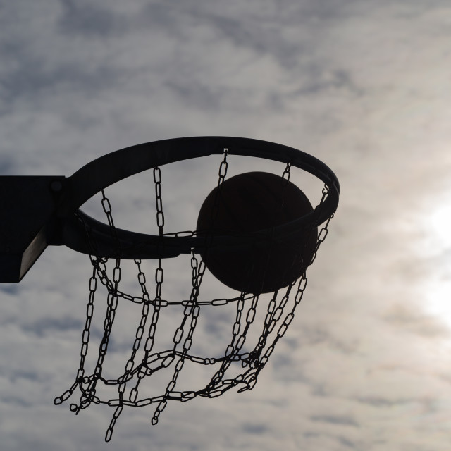 """Basketball hoop at sunset sky 3"" stock image"