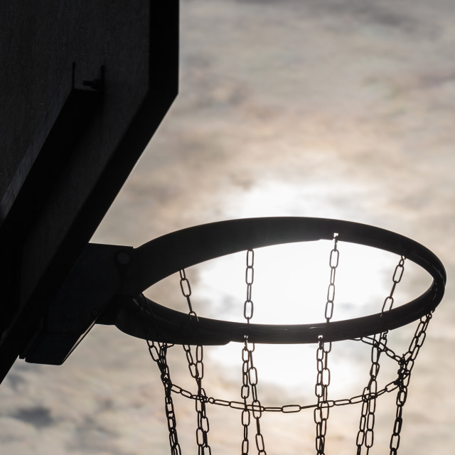 """Basketball hoop at sunset sky 8"" stock image"