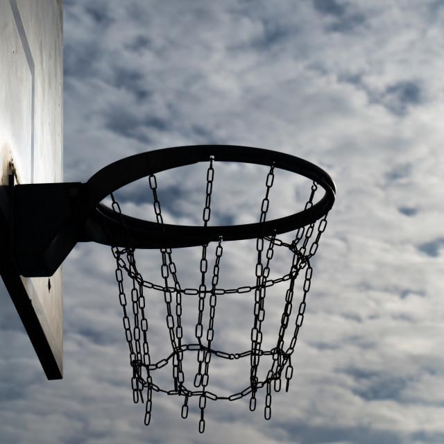 """Basketball hoop at sunset sky 7"" stock image"