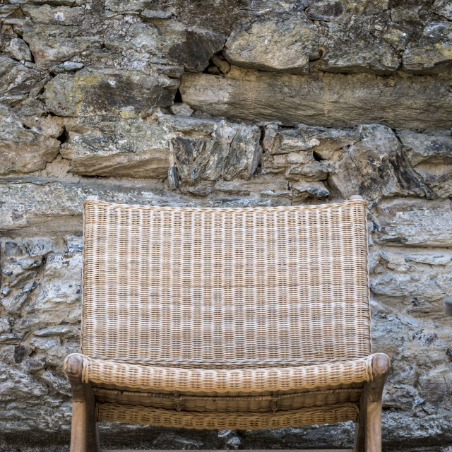 """""""a rustic chair in a garden"""" stock image"""