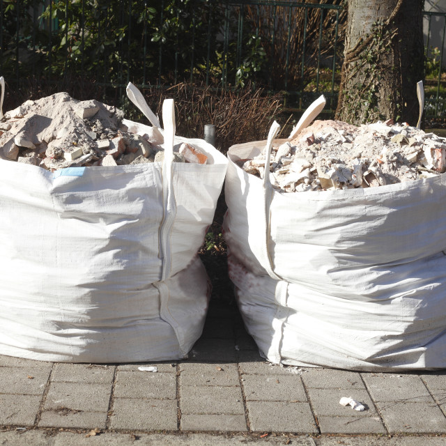 """white garbage bags with rubble stones"" stock image"