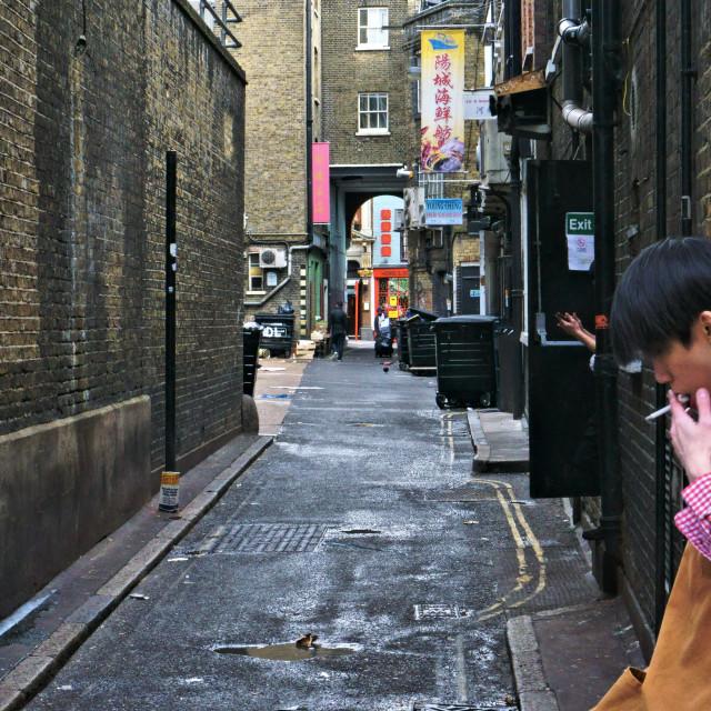 """""""Smoke break in Chinatown"""" stock image"""