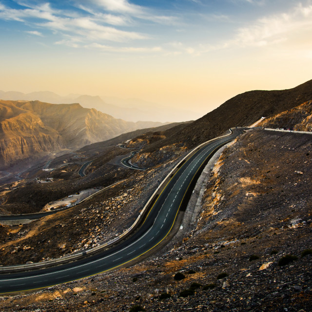 """""""Jabal Jais mountain road at sunset. The highest mountain in the"""" stock image"""