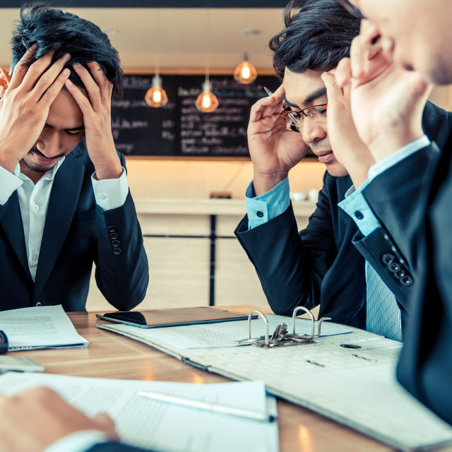 """""""Businessmen are pressured to work and unsuccessful"""" stock image"""