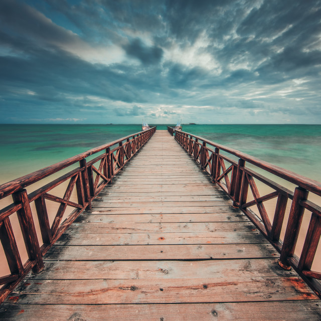 """""""Wooden jetty reaching into the turquoise Caribbean sea"""" stock image"""