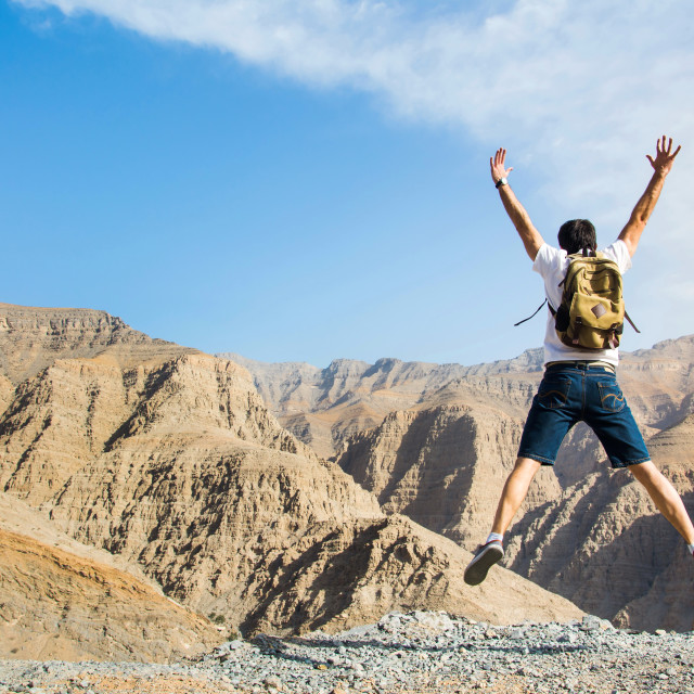 """Man jumping on the mountain top"" stock image"