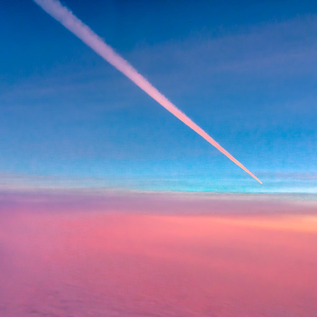 """sunset contrail"" stock image"