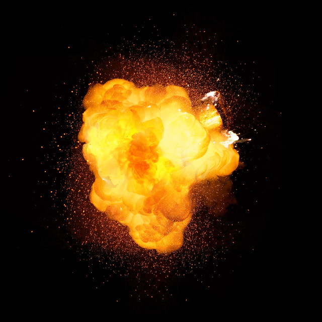 """Fiery bomb explosion isolated on black background"" stock image"