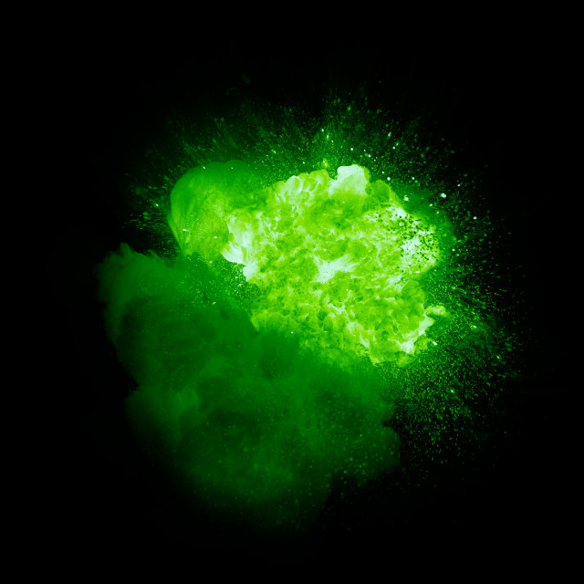 """Realistic green plasma explosion with sparks and smoke isolated on black background"" stock image"