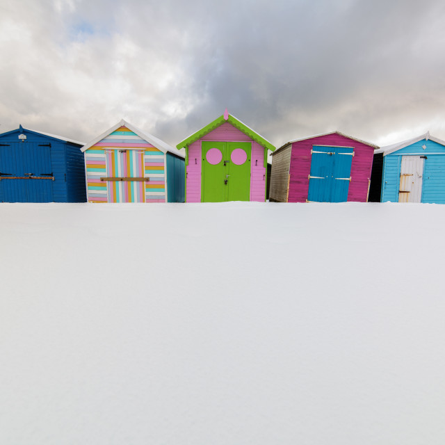 """Snow Beach Huts Of Harwich"" stock image"