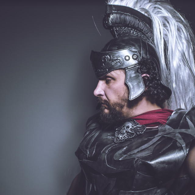 """""""Conquest Roman gladiator, wrestler and warrior of Rome with helmet and red..."""" stock image"""