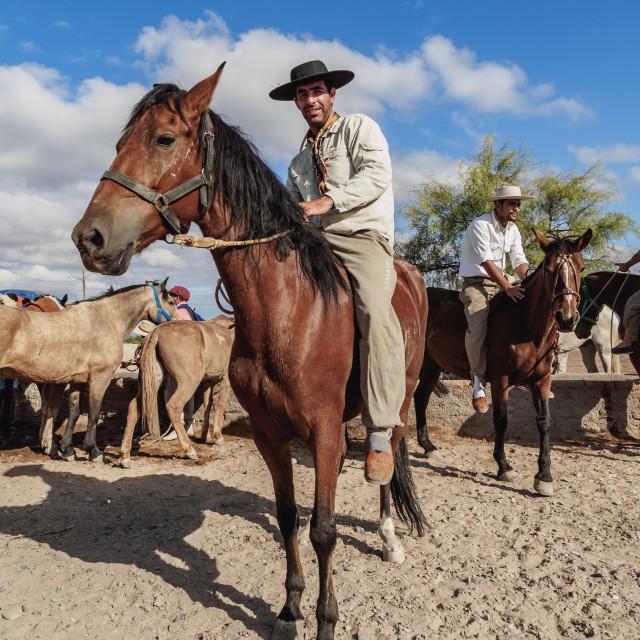 """Gauchos with horses, Vallecito, San Juan Province, Argentina"" stock image"