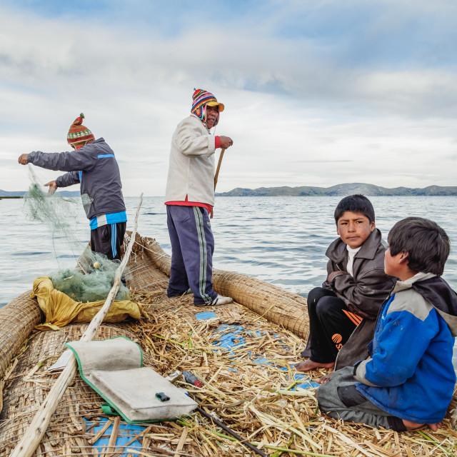"""Fishing on Uros Floating Islands, Lake Titicaca, Puno Region, Peru"" stock image"