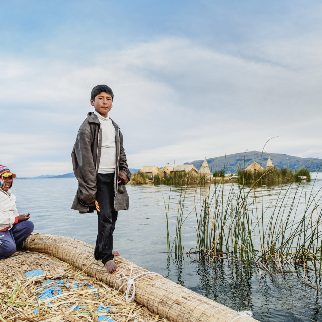 """""""Native Uro People on the Reed Boat, Uros Floating Islands, Lake Titicaca,..."""" stock image"""