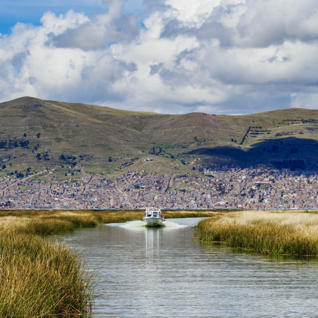 """""""Boat going from Puno to Uros Floating Islands, Lake Titicaca, Puno Region, Peru"""" stock image"""