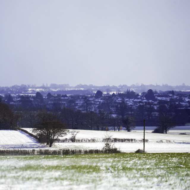 """""""A view over the snowy fields of Essex"""" stock image"""