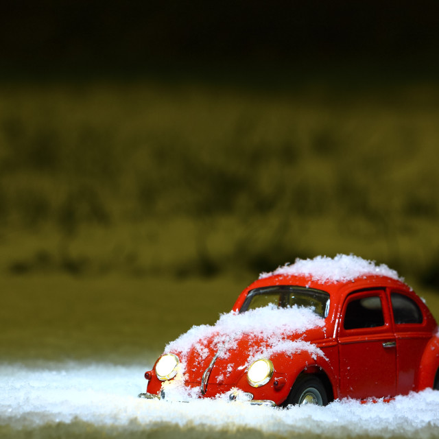 """""""Toy red car with illuminated headlights"""" stock image"""