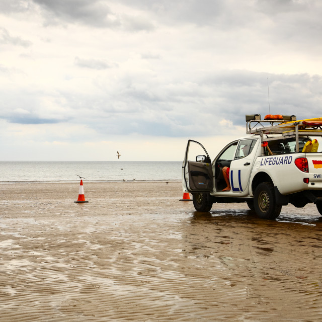 """""""Lifeguard on duty at filey bay yorkshire"""" stock image"""