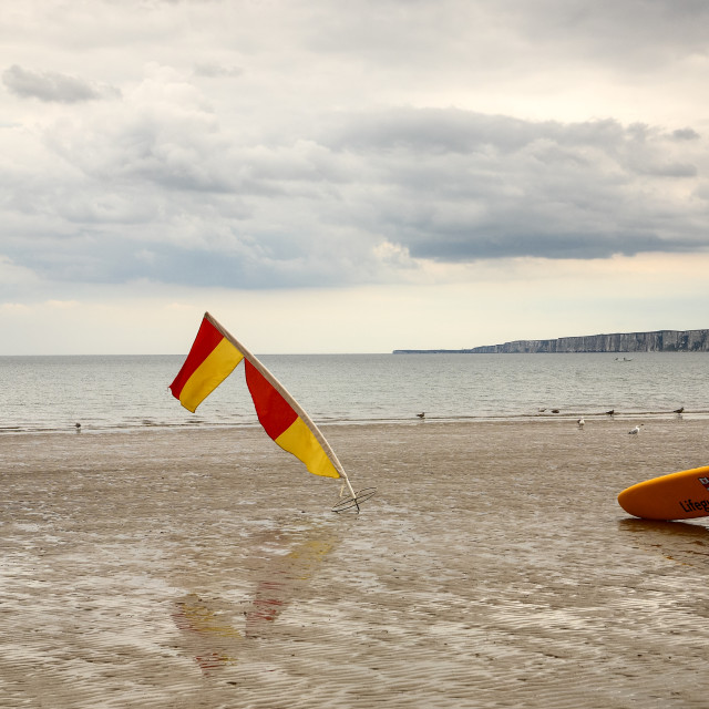 """""""Lifeguard's surfboard and saftey flag on the beach at filey bay yorkshire"""" stock image"""