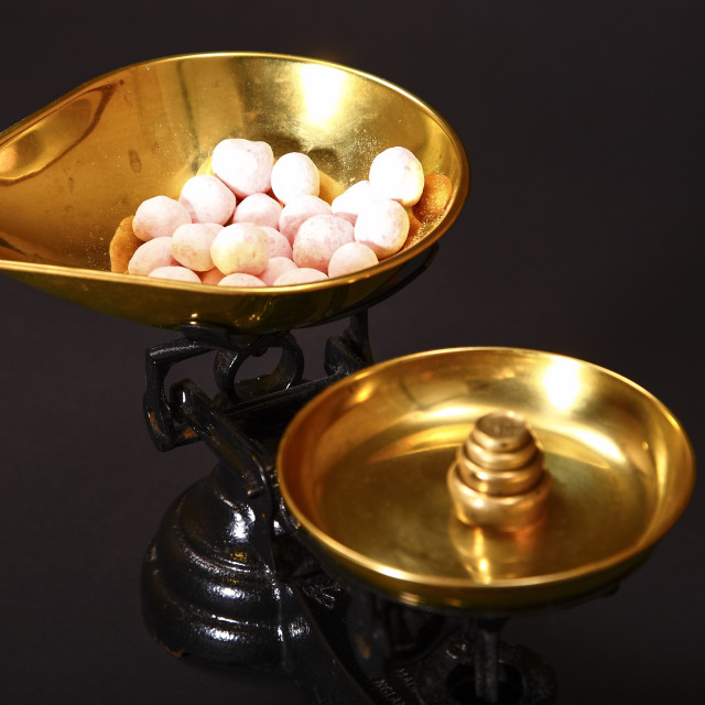 """Sweets being weighed in vintage scales"" stock image"