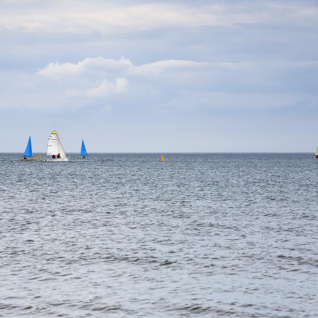 """""""yachts sailing on the sea at Filey bay"""" stock image"""