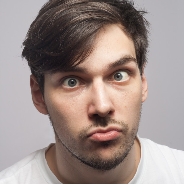 """Man portrait cross squint skew eye portrait."" stock image"