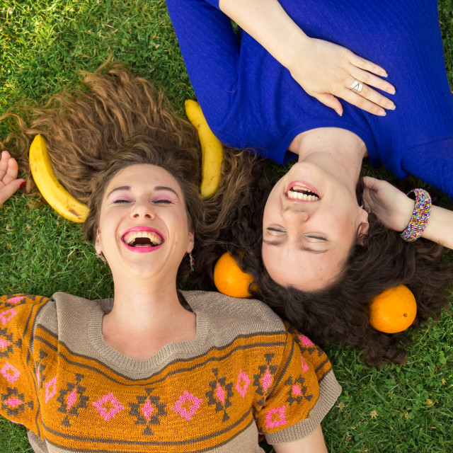 """""""Two young girls women Laughing elevated view"""" stock image"""