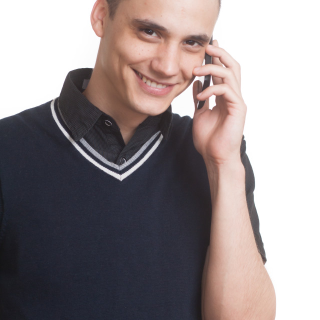 """""""Young adult boy talking on phone."""" stock image"""