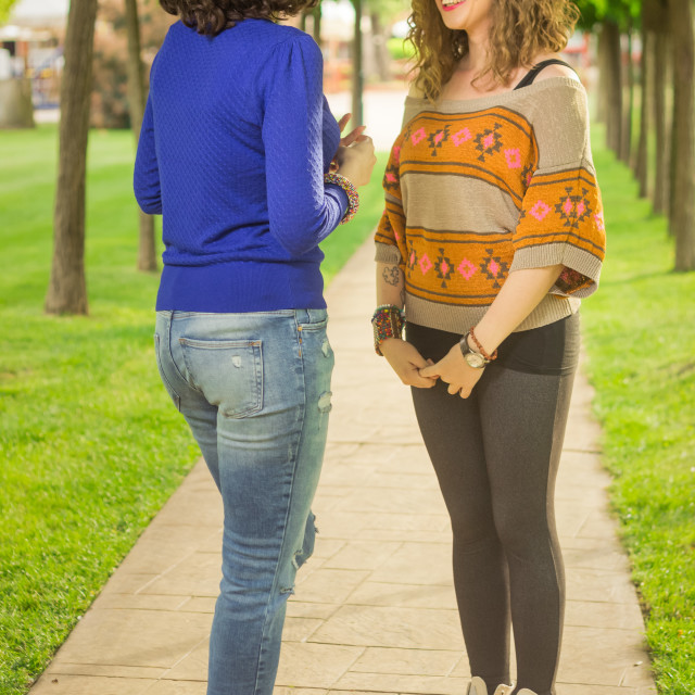 """""""young girls talking listening"""" stock image"""