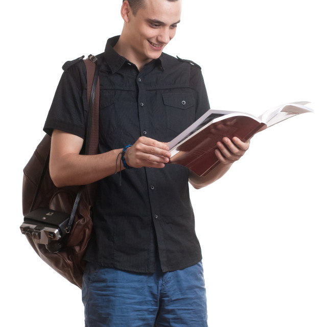 """""""Young student reading a book."""" stock image"""