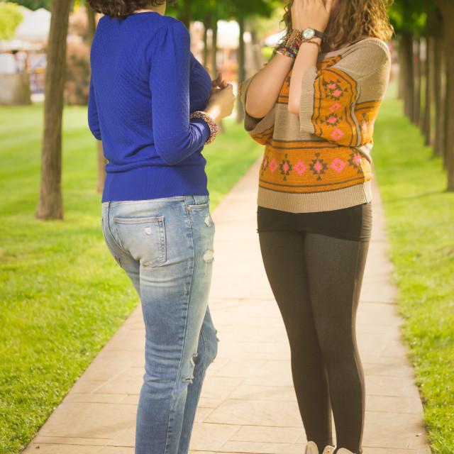 """Young women talking shocked disbelief"" stock image"