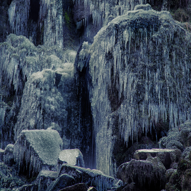 """Frozen rocks and icicles"" stock image"