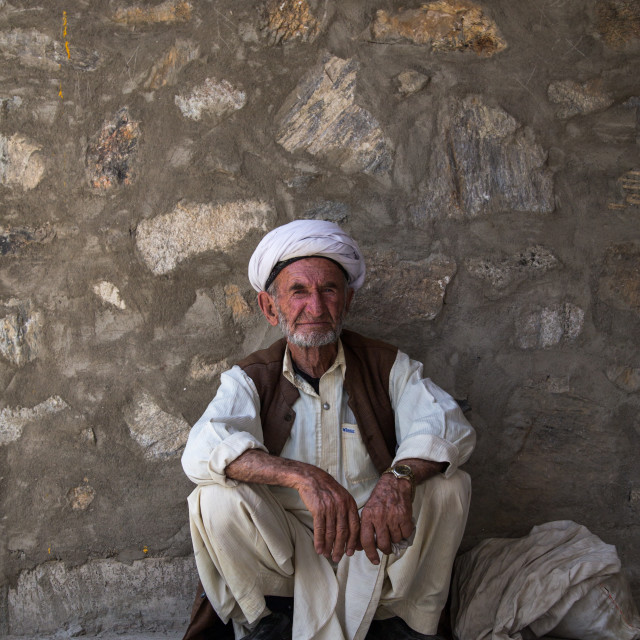 """Portrait of an old afghan man in the market border with Afghanistan, Central..."" stock image"