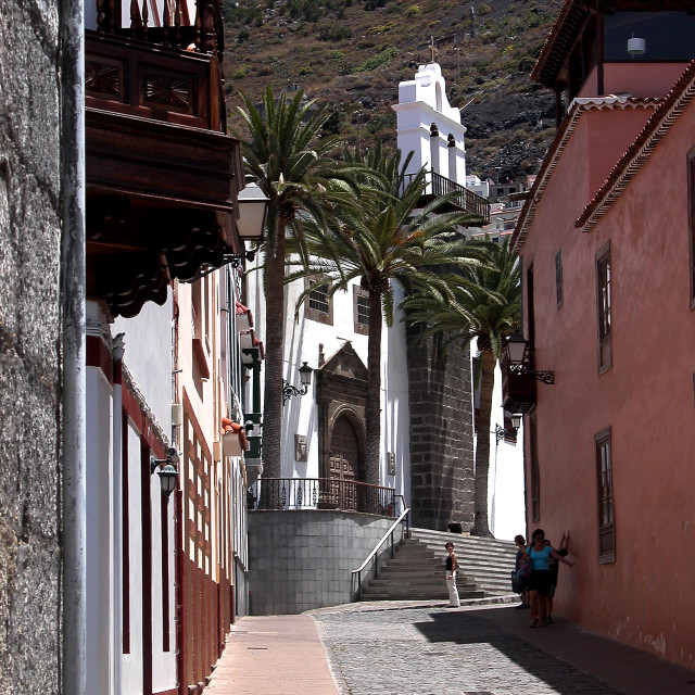 """""""Narrow Canarian street lading to the church steps Tenerife,"""" stock image"""
