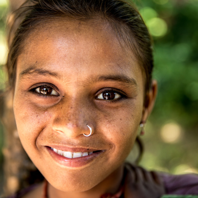 """""""Young girl from a small village smiling in India"""" stock image"""