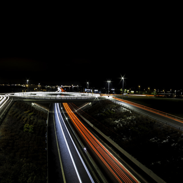 """""""light trails for cars passing a roundabout and roadside sides"""" stock image"""
