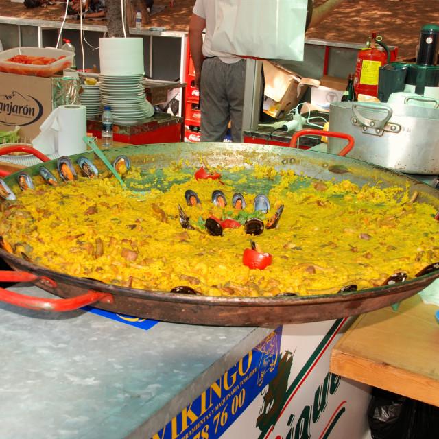 """Paella cooking at the Romeria San Bernabe festival, Marbella, Spain"" stock image"