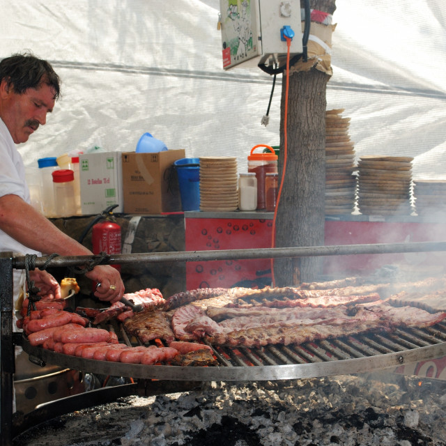 """""""Chef cooking meat at a Spanish fiesta"""" stock image"""