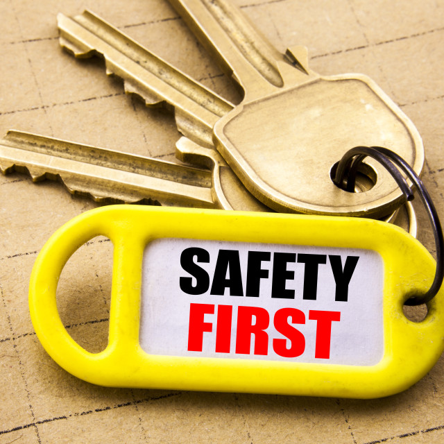 """""""Word, writing Safety First. Business concept for Safe Warning Written on key..."""" stock image"""