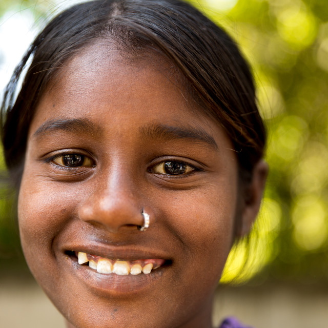 """""""Girl from a small village smiling in India"""" stock image"""