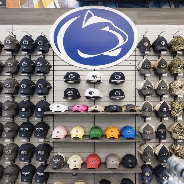 """""""Souvenir hats displayed in the Penn State bookstore"""" stock image"""