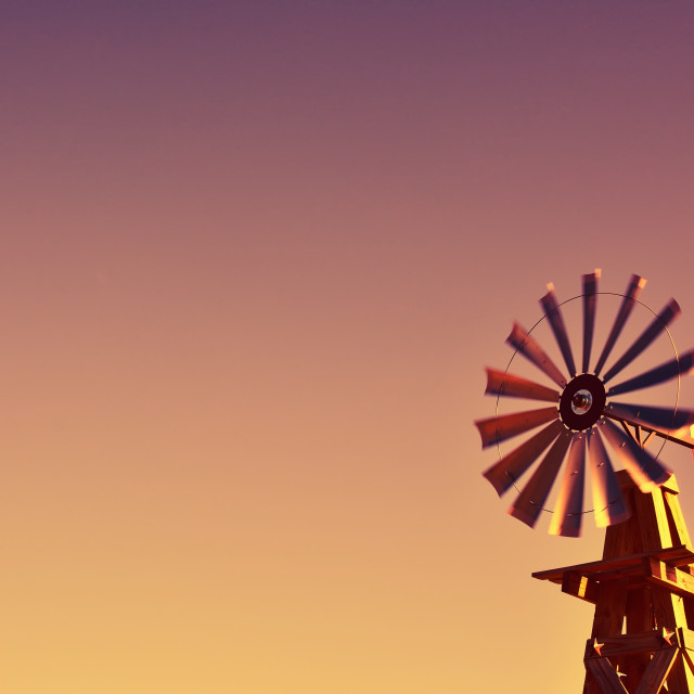 """Windmill on an agricultural farm in USA."" stock image"